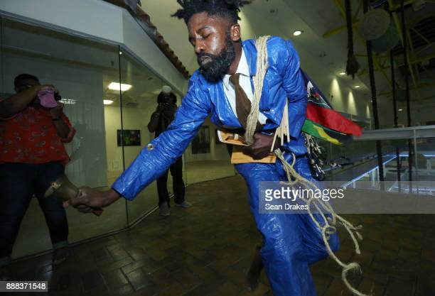 Nyugen E Smith performs a multimedia reflection on the effects of climate change on the Caribbean titled 'Lest We Forget' at Prizm Art Fair on East...
