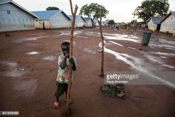 Nyumanzi transit camp A young boy is seen after a rainstorm Hundreds of people are crammed into large tents living in this transit camp for months...