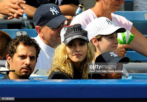 Yankees vs Cincinnati Reds at Yankee Stadium., Singer Madonna was at the game with her children Rocco?, Lourdes and adopted son David, who's on her...