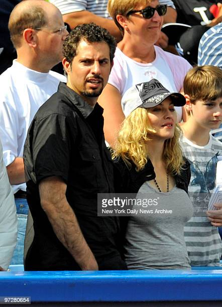 Yankees vs Cincinnati Reds at Yankee Stadium., Singer Madonna with agent Guy Oseary.