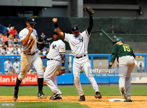 Yankees vs Oakland Athletics at Yankee Stadium., New York Yankees shortstop Derek Jeter tags out Oakland Athletics center fielder Ryan Sweeney at 2nd...