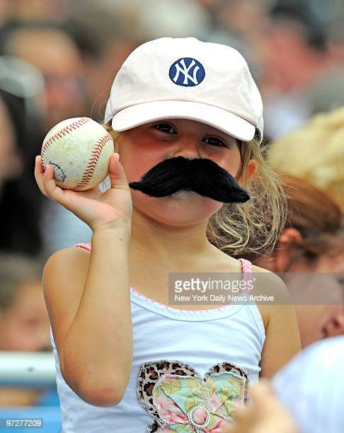 Yankees vs Tampa Bay Rays at Yankee Stadium., It was Giambi moustache day at the Stadium. , Lillian Acamporia, 6 from Conn. Shows off her game ball.