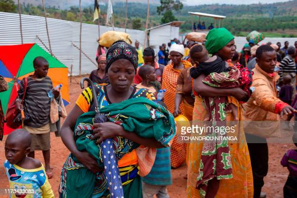 Nzeyimana Consolate arrives carrying her baby at the Nyabitara Transit site, among other Burundian refugees on October 3, 2019 in Ruyigi, Burundi. -...