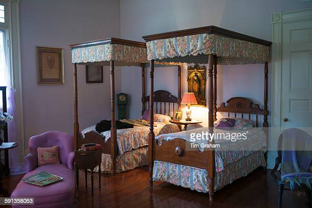 Oak Alley plantation antebellum mansion house interior of bedroom with four poster beds in Vacherie Louisiana USA