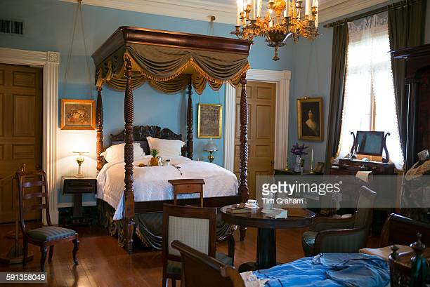 Oak Alley plantation antebellum mansion house interior of master bedroom with four poster bed in Vacherie Louisiana USA