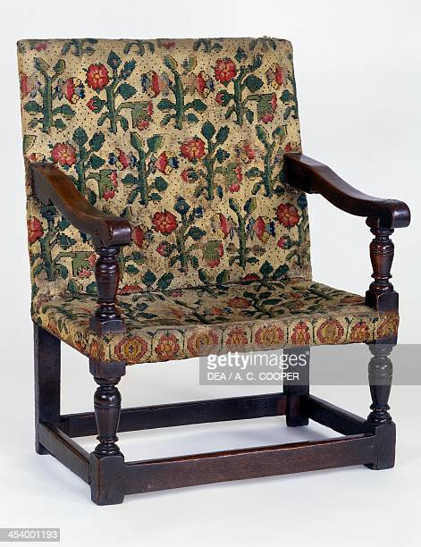 Oak armchair upholstered in Turkey Work fabric England 17th century London Victoria And Albert Museum