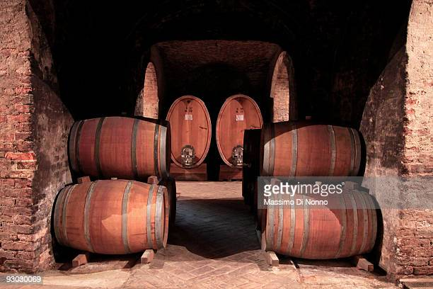 Oak barrels in a cellar where the wine is left to rest for two years on October 6 2009 in Novello near Cuneo Italy Barolo wine is produced in Cuneo...