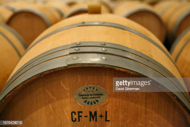 Oak casks made by the Tonnellarie des Domaines Barons de Rothschild at Château Lafite fill the wineaging cellar at Château Clarke on June 25 2018 in...
