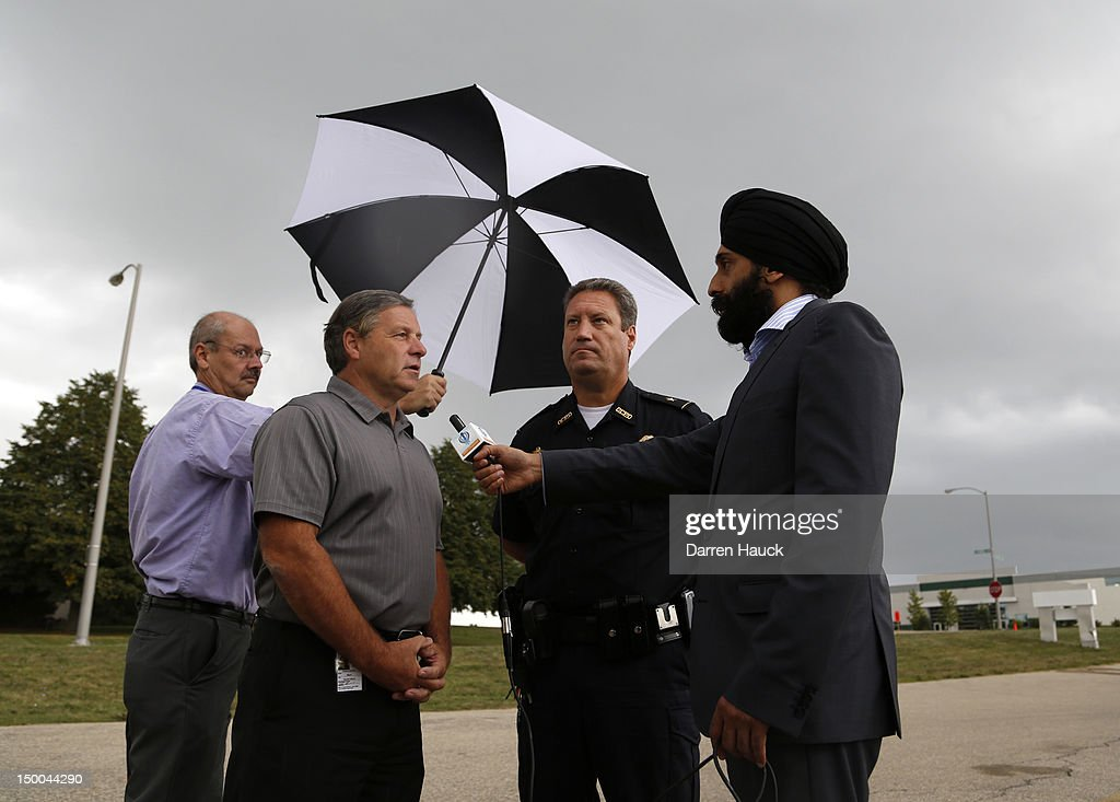 Oak Creek Mayor Steve Scaffidi (2nd L) and Police Chief John Edwards are interviewed across the street from where the mass shooting at the Sikh Temple of Wisconsin took place August, 9, 2012 in Oak Creek, Wisconsin. Suspected gunman, 40-year-old Wade Michael Page, allegedly killed six people at the temple on August 5 and then killed himself at the scene. He was an army veteran and reportedly a former member of a white supremacist heavy metal band. Three others were critically wounded in the attack.