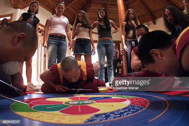 Oak Grove School students watch as Tibetan monks visiting Oak Grove School in Ojai, Tuesday create a sand mandala meant to further compassion, peace...