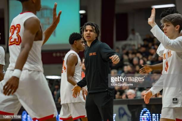 Oak Hill Academy Warriors guard Cole Anthony cheers on his teammates during a timeout during the first half of the high school basketball game...