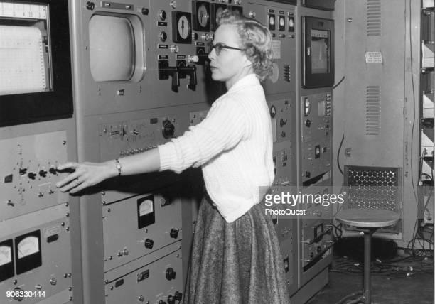 Oak Ridge National Laboratory reactor operator Elizabeth Johnson adjust the controls for the Y12 'swimming pool' nuclear reactor Oak Ridge Tennessee...