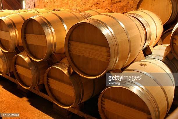 Oak Wine Barrel Stacks in Winery Cellar, Napa Valley, California