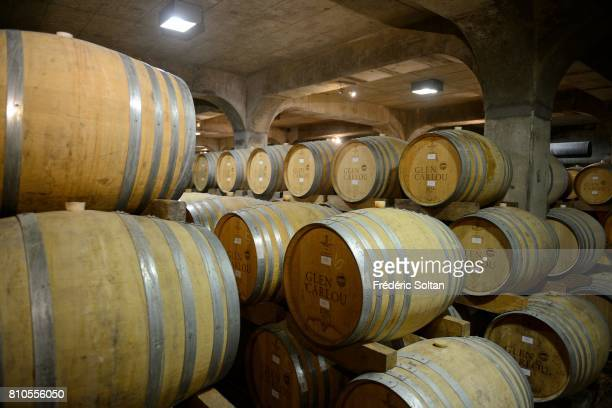 Oak wine barrels full of aging red wine Western Cape Province on April 16 2017 in South Africa