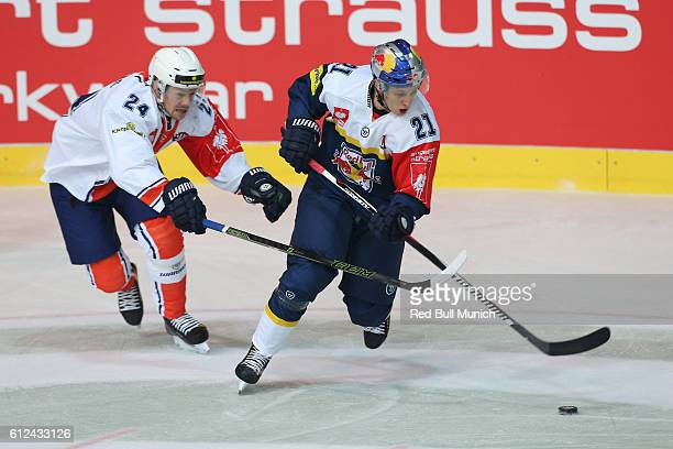 Oakim Hillding of Vaxjo and Dominik Kahun of Munich during the Champions Hockey League Round of 32 match between Red Bull Munich and Vaxjo Lakers at...