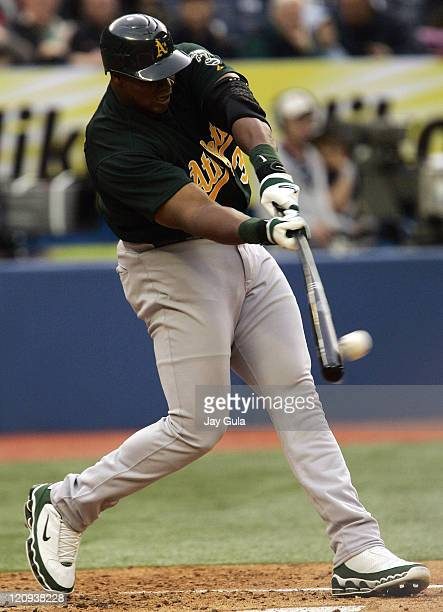 Oakland A's DH Frank Thomas connects for a 2 run HR off of the Blue Jays Gustavo Chacin in MLB action at Rogers Centre in Toronto Canada May 10 2006