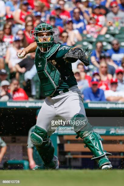Oakland Athletics Catcher Josh Phegley fields a a ball during the MLB baseball game between the Oakland Athletics and Texas Rangers on April 9 2017...
