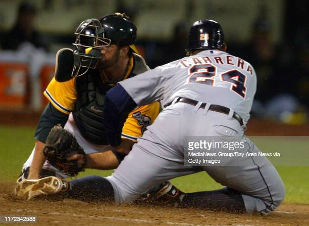Oakland Athletics' catcher Landon Powell, left, tags out Detroit Tigers' Miguel Cabrera at home in the fourth inning of their MLB game at O.co...
