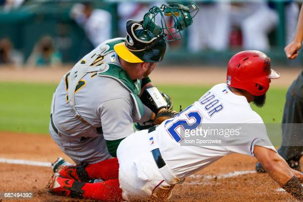 Oakland Athletics Catcher Stephen Vogt tags Texas Rangers Second base Rougned Odor out at the plate during the MLB game between the Oakland Athletics...