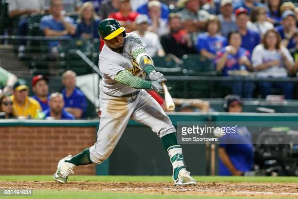 Oakland Athletics Center field Rajai Davis breaks his bat on a ground ball during the MLB game between the Oakland Athletics and Texas Rangers on May...