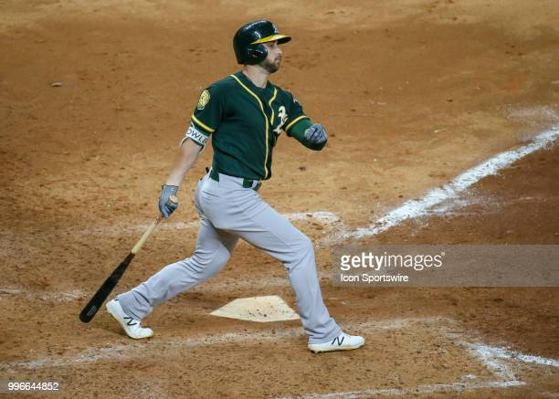 Oakland Athletics center fielder Dustin Fowler reacts after hitting a foul in the top of the ninth inning during the baseball game between the...