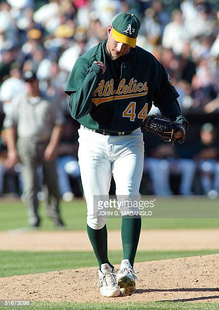 Oakland Athletics' closing pitcher Billy Koch pumps his fist after striking out Texas Rangers' slugger Alex Rodriguez for the final out during the...