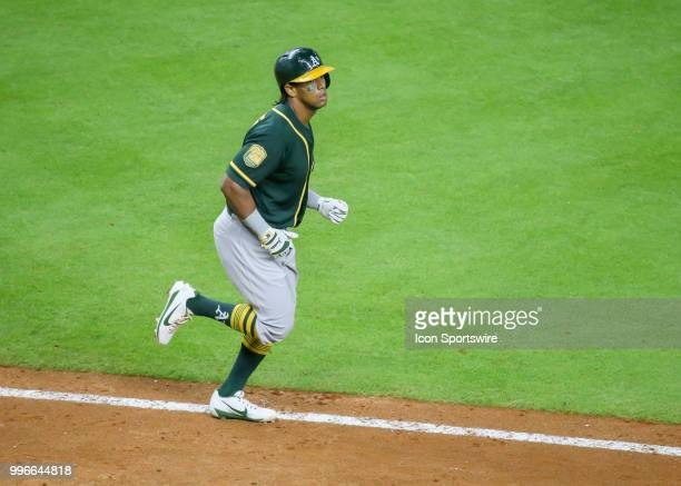 Oakland Athletics designated hitter Khris Davis gets a walk in the top of the eighth inning during the baseball game between the Oakland Athletics...