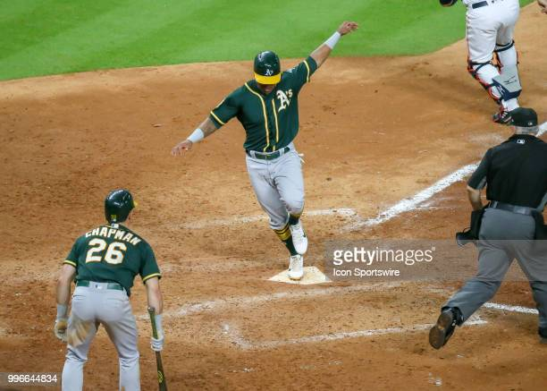 Oakland Athletics designated hitter Khris Davis scores a run in the top of the eighth inning during the baseball game between the Oakland Athletics...