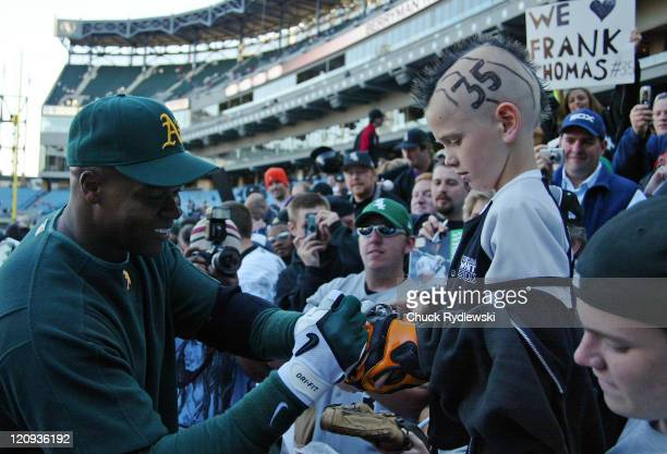 Oakland Athletics' DH and exWhite Sox Frank Thomas signs autographs prior to their game against the Chicago White Sox May 22 2006 at US Cellular...