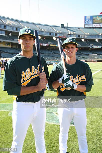Oakland Athletics draft picks Matt Olsen and Daniel Robertson hangout on the field prior to the game against the Los Angeles Dodgers at the...