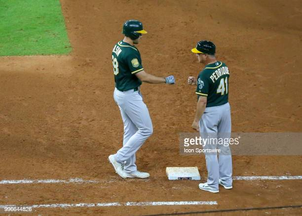 Oakland Athletics first baseman Matt Olson gets a walk in the top of the eighth inning during the baseball game between the Oakland Athletics and...