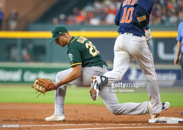 Oakland Athletics first baseman Matt Olson gets an out on Houston Astros first baseman Yuli Gurriel in the bottom of the second inning during the...