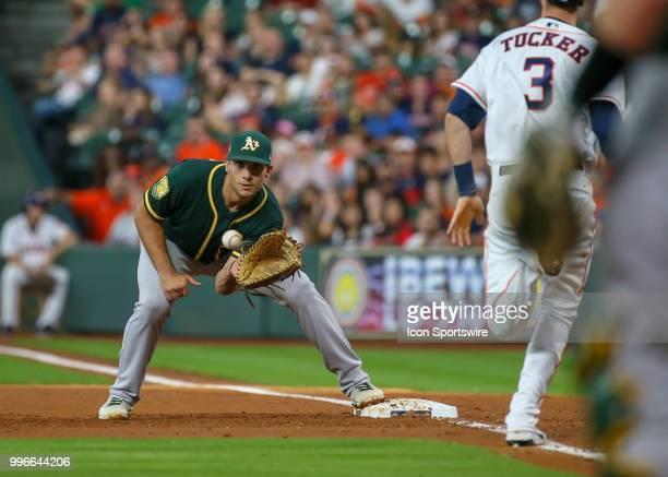 Oakland Athletics first baseman Matt Olson gets an out on Houston Astros left fielder Kyle Tucker during the baseball game between the Oakland...