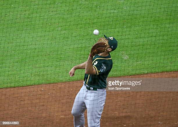 Oakland Athletics first baseman Matt Olson gets an out on Houston Astros third baseman Alex Bregman in the bottom of the ninth inning during the...