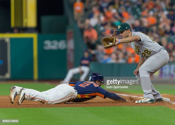 Oakland Athletics first baseman Matt Olson is unable to pick off Houston Astros shortstop Alex Bregman during the MLB game between the Oakland...