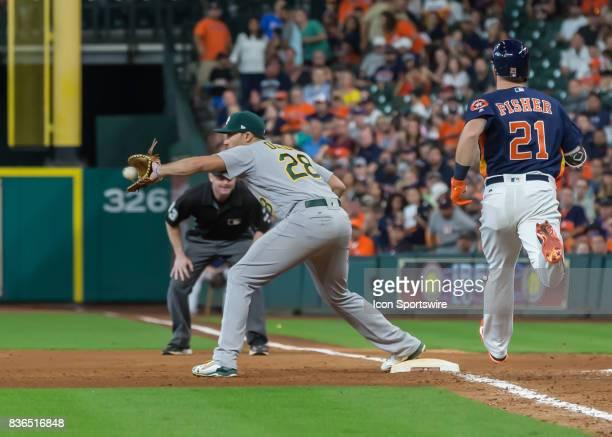 Oakland Athletics first baseman Matt Olson makes an out on Houston Astros left fielder Derek Fisher during the MLB game between the Oakland Athletics...