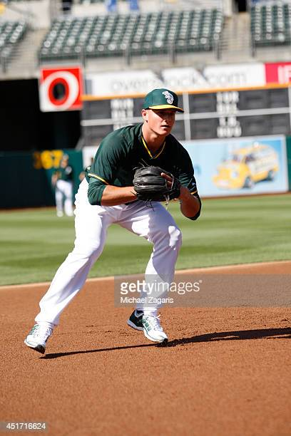 Oakland Athletics first round draft pick Matt Chapman takes infield prior to the game against the Texas Rangers at Oco Coliseum on June 16 2014 in...