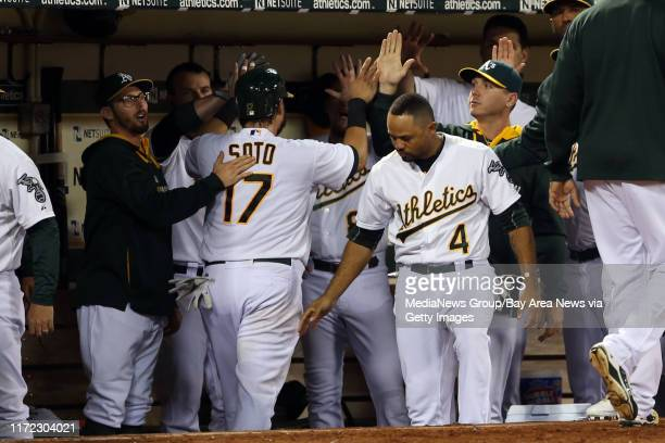Oakland Athletics' Geovany Soto is welcome back in the dugout as hey celebrate an RBI single by Sam Fold against the Texas Rangers in the fifth...