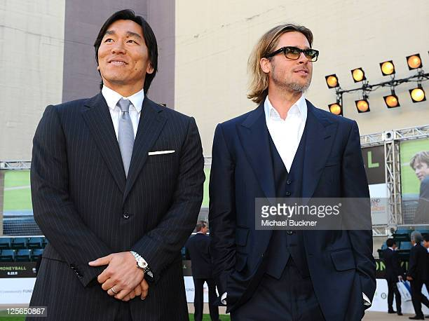 Oakland Athletics' Hideki Matsui and actor Brad Pitt arrives at the premiere of Columbia Pictures' Moneyball at the Paramount Theatre of the Arts on...