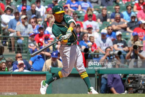 Oakland Athletics left fielder Khris Davis hits a double during the game between the Oakland Athletics and Texas Rangers on April 14 2019 at Globe...