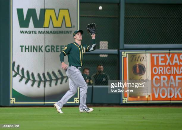 Oakland Athletics left fielder Mark Canha catches a pop fly during the baseball game between the Oakland Athletics and Houston Astros on July 9 2018...