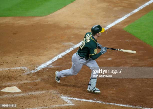 Oakland Athletics left fielder Mark Canha watches his hit in the top of the eighth inning during the baseball game between the Oakland Athletics and...