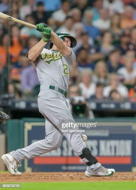 Oakland Athletics left fielder Matt Joyce gets hit by the ball after bouncing off his bat during the MLB game between the Oakland Athletics and...