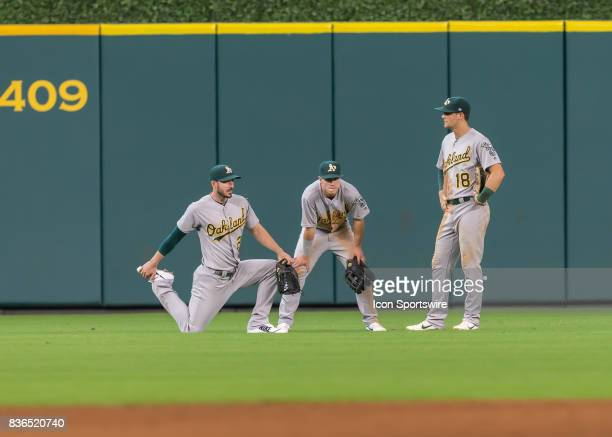 Oakland Athletics left fielder Matt Joyce Oakland Athletics center fielder Boog Powell and Oakland Athletics right fielder Chad Pinder warm up...