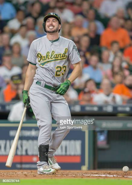 Oakland Athletics left fielder Matt Joyce reacts after being hit by a ball during the MLB game between the Oakland Athletics and Houston Astros on...