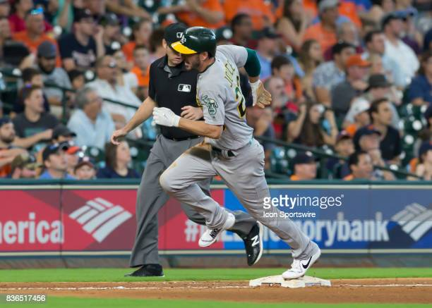 Oakland Athletics left fielder Matt Joyce steps on third base during the MLB game between the Oakland Athletics and Houston Astros on August 20 2017...