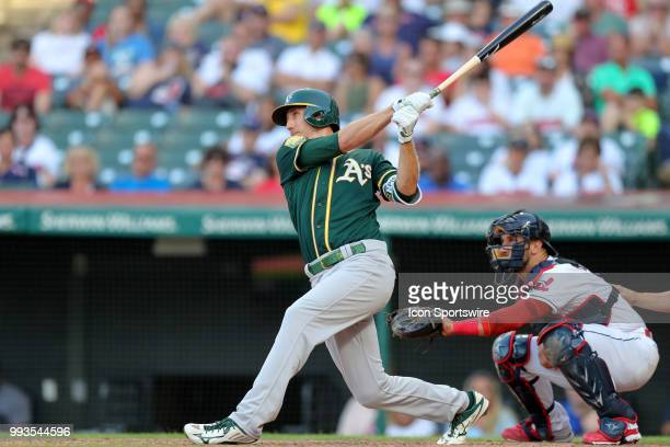 Oakland Athletics outfielder Stephen Piscotty launches a 2run home run to the left field seats during the eleventh inning of the Major League...