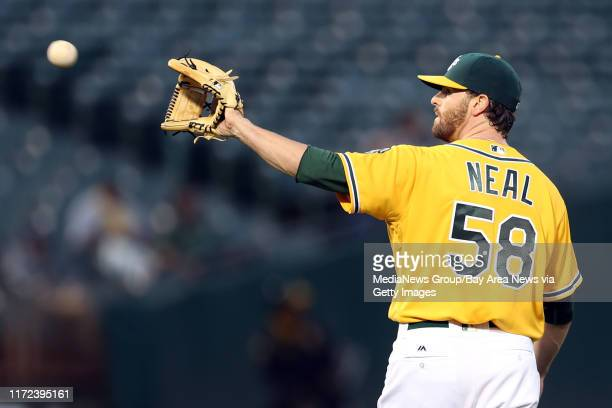 Oakland Athletics pitcher Zach Neal gets a new ball as Baltimore Orioles' Adam Jones circles the bases on a home run in the fourth inning of a MLB...