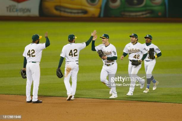 Oakland Athletics players celebrate after a win against the Detroit Tigers at RingCentral Coliseum on April 15, 2021 in Oakland, California. All...