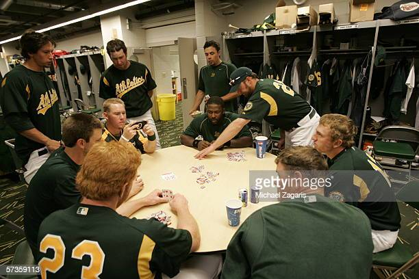 Oakland Athletics players play cards in the clubhouse before the Spring Training game against the Chicago Cubs at Phoenix Municipal Stadium on March...